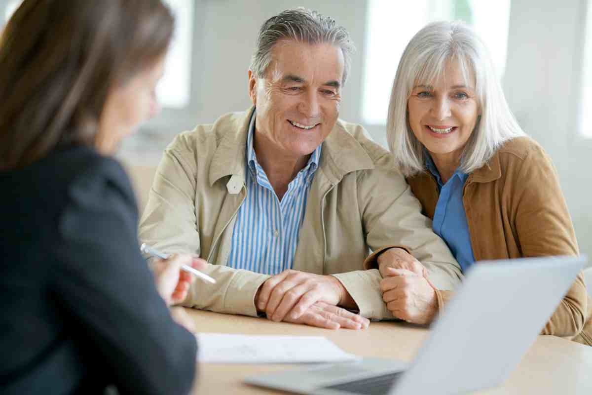 old couple talking to a financial advisor | Top Retirement Investments | Inside Your IRA | ira