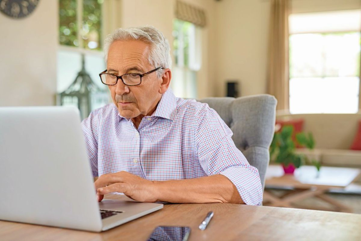 senior man working on a laptop home | Roth IRA Income Limits for 2019: Everything You Need To Know | roth ira contribution limits
