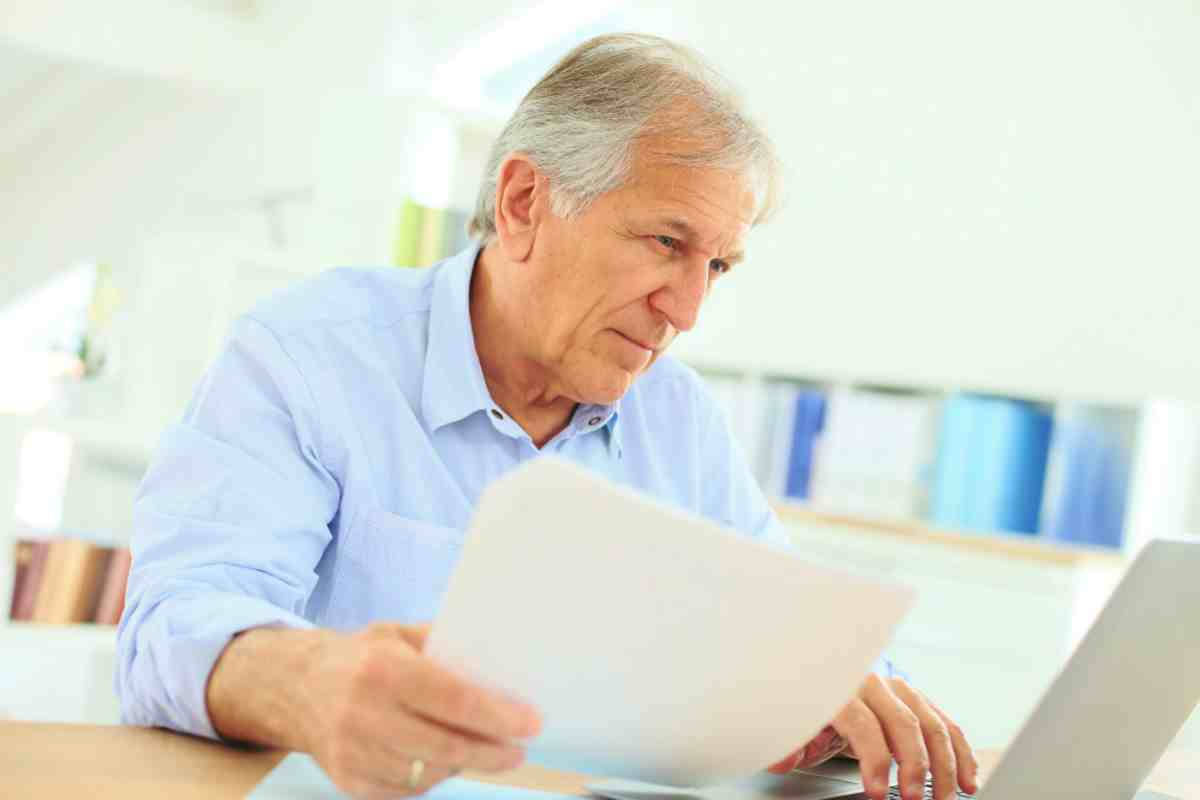 senior man looking at his files | Top Retirement Investments | Inside Your IRA | ira