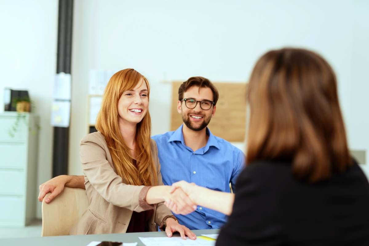 women doing handshake | Reasons Why You Should Get A Financial Advisor | what do financial advisors do