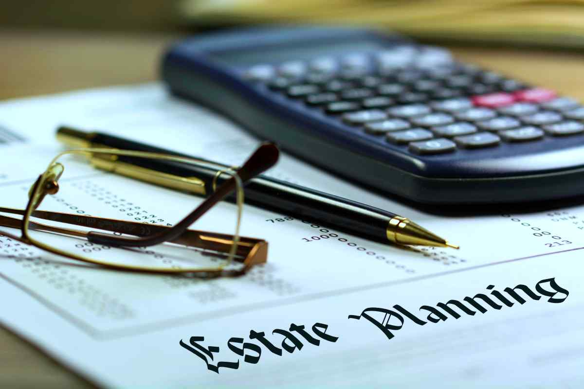 estate planning calculator and pen   How Your IRA Can Affect Your Tax Bracket   Federal tax brackets