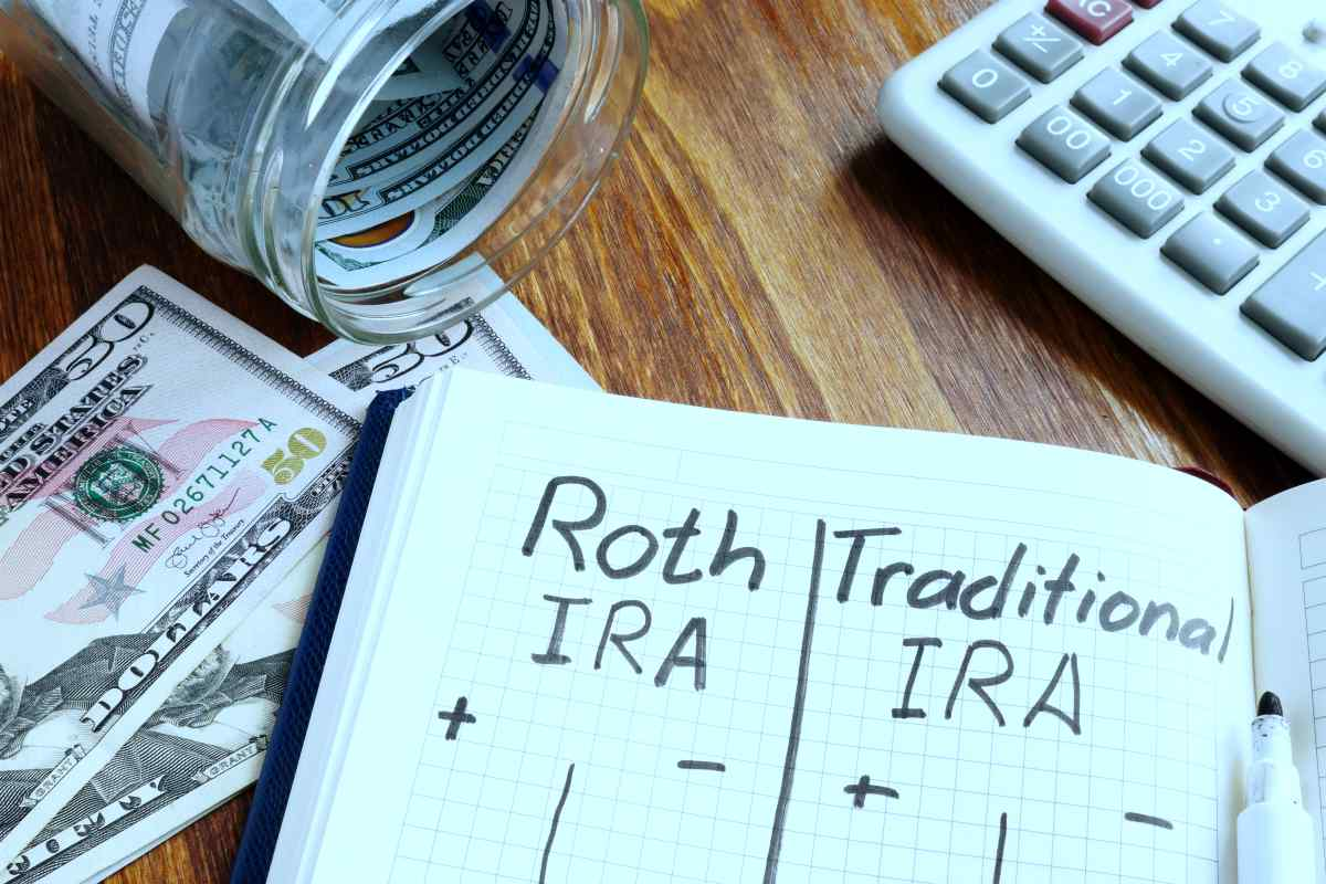 roth vs traditional ira pros and cons written on notepad   How Your IRA Can Affect Your Tax Bracket   IRS Taxes