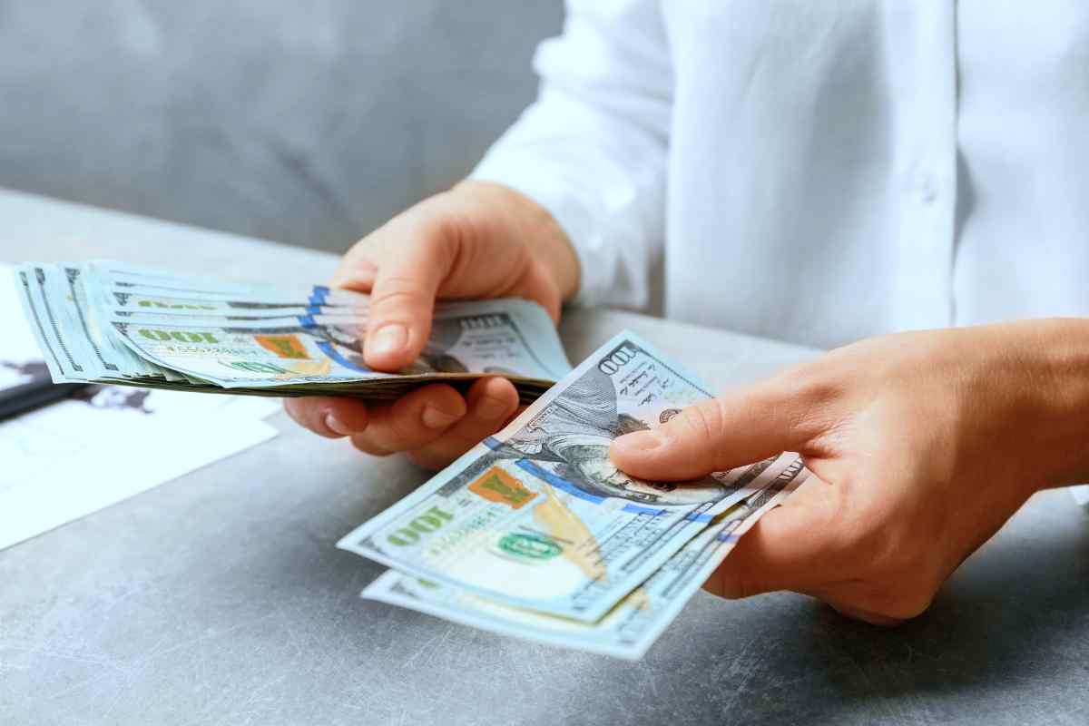 woman counting money   How Your IRA Can Affect Your Tax Bracket   Old and new tax brackets