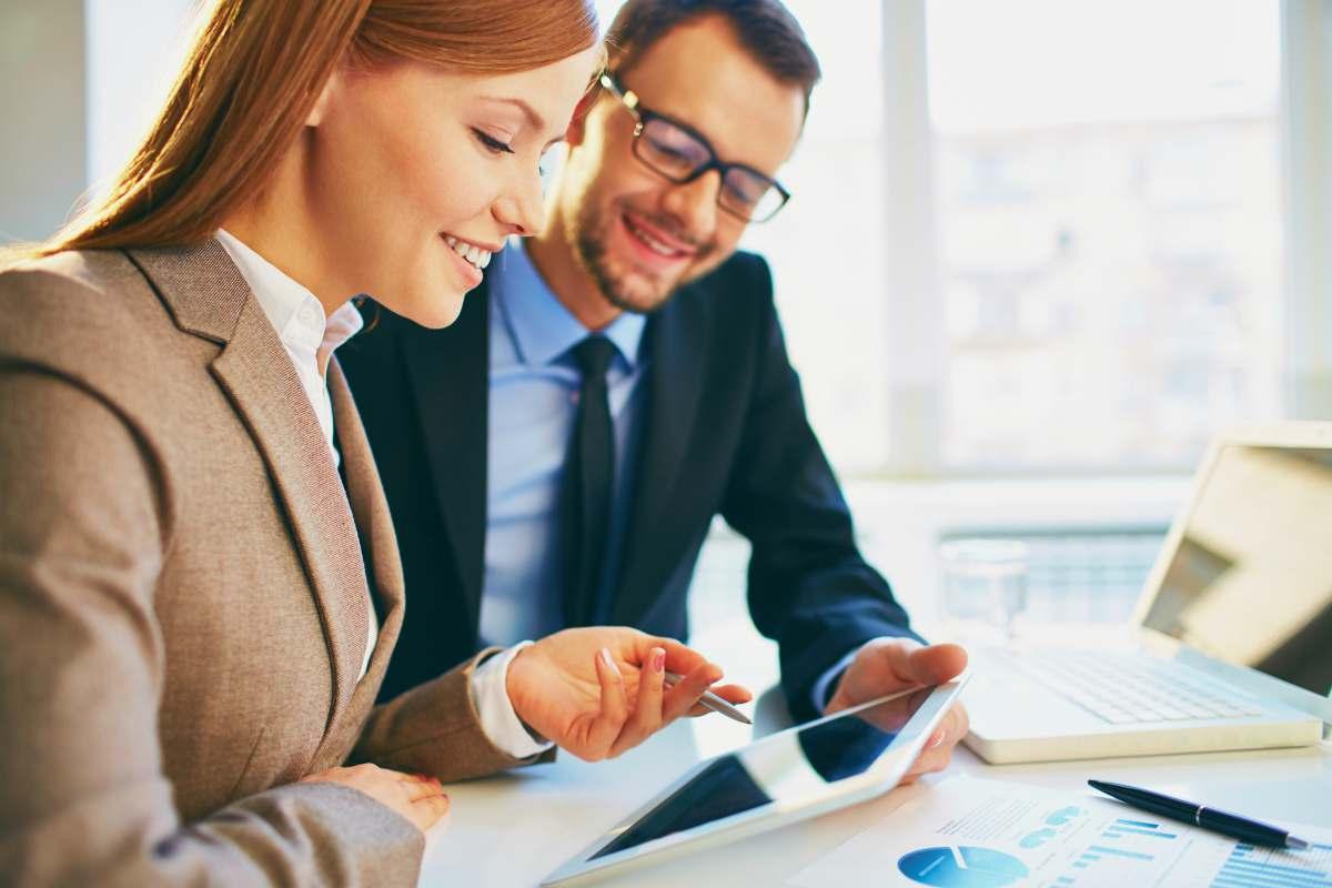 businesswoman explaining report | Reasons Why You Should Get A Financial Advisor | financial adviser