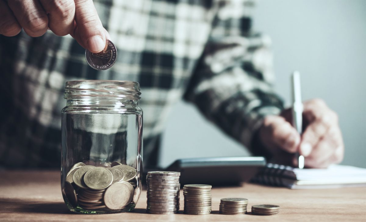 man putting coins on glass bottle | Can You Have Multiple IRAs? | Inside Your IRA | can i have multiple iras