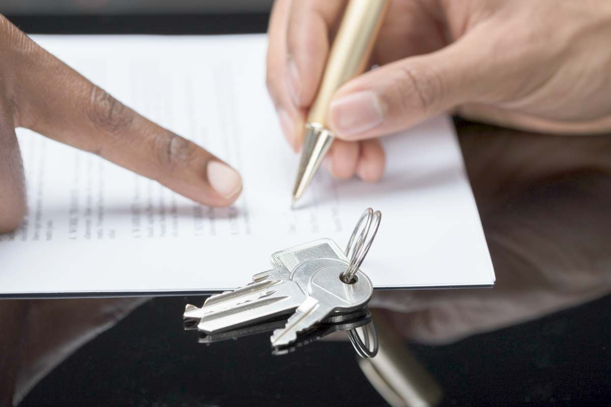 hand signing contract | Real Estate IRA Rules Any Interested IRA Owner Should Know | self directed ira real estate rules
