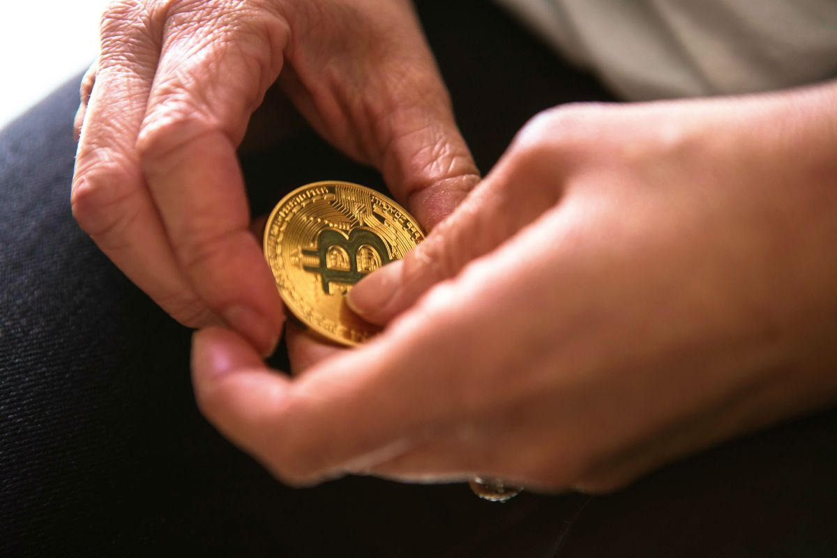 hand holding bitcoin   Why Diversification Of Investments Is An Important Strategy To Make   Inside Your IRA   what is diversification