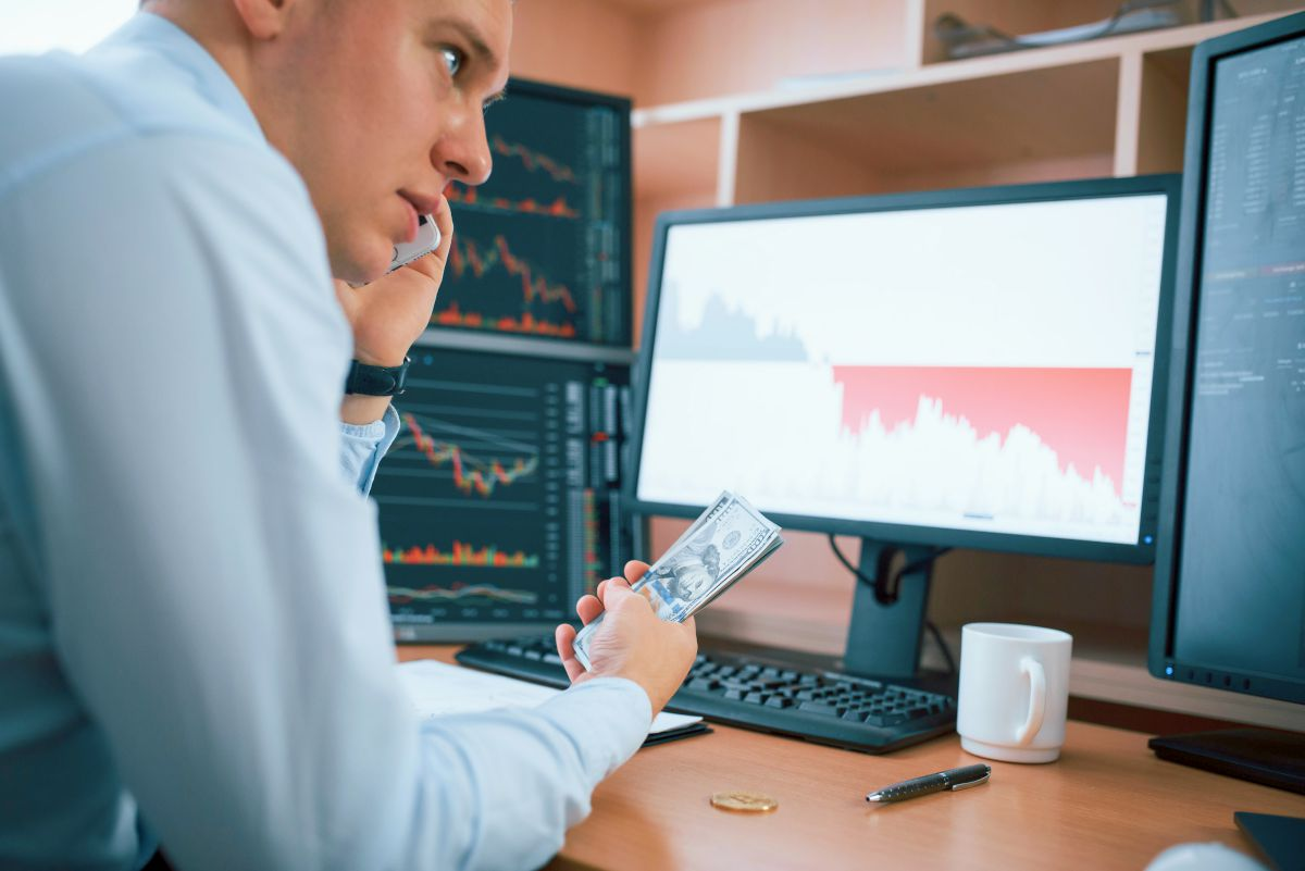 businessman holding money   Why Diversification Of Investments Is An Important Strategy To Make   Inside Your IRA   portfolio diversification