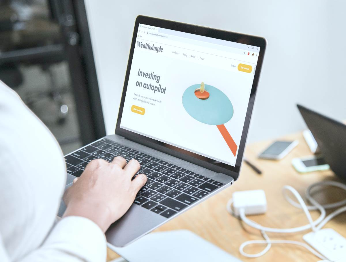 person using laptop | Best Robo Advisors For Your IRA | top robo advisors