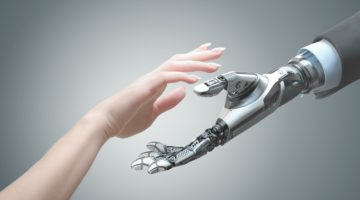 Feature | robot helping human | Best Robo Advisors For Your IRA | best robo advisors