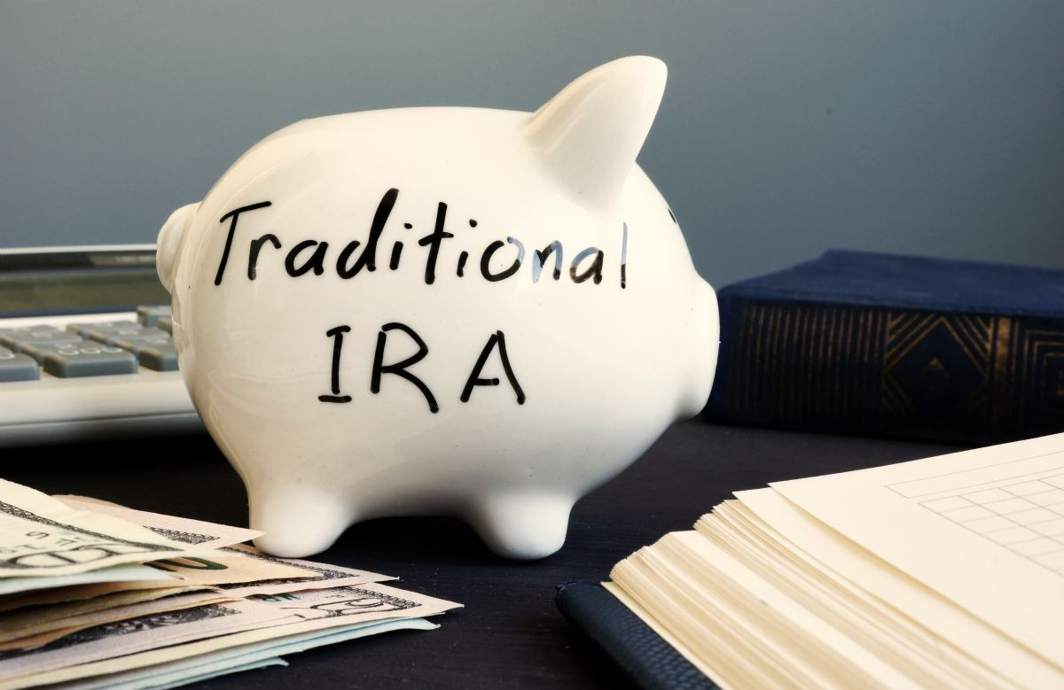 Traditional IRA written on piggy bank | What To Do When Your Employer Stopped Matching Your 401K | Inside Your IRA | employer match 401k