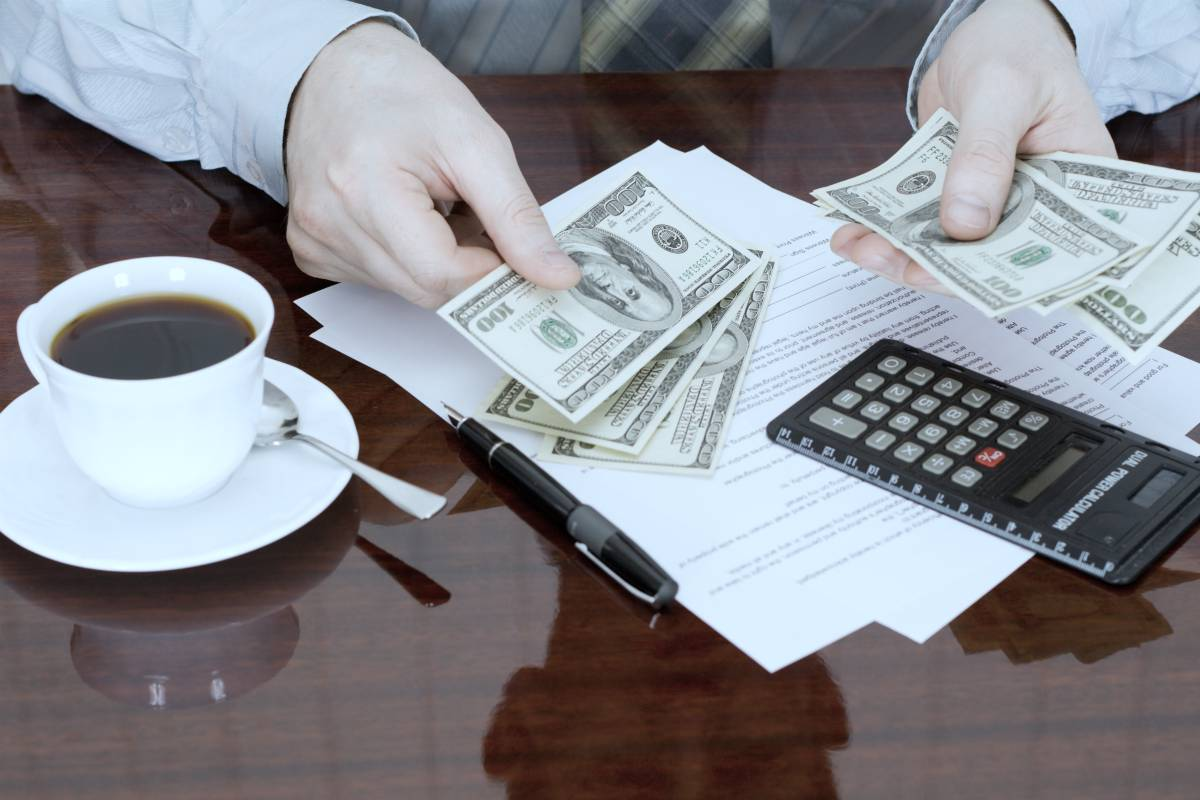 businessman counting money | When To Choose IRA Trust Over IRA LLC | Inside Your IRA | ira beneficiary trust