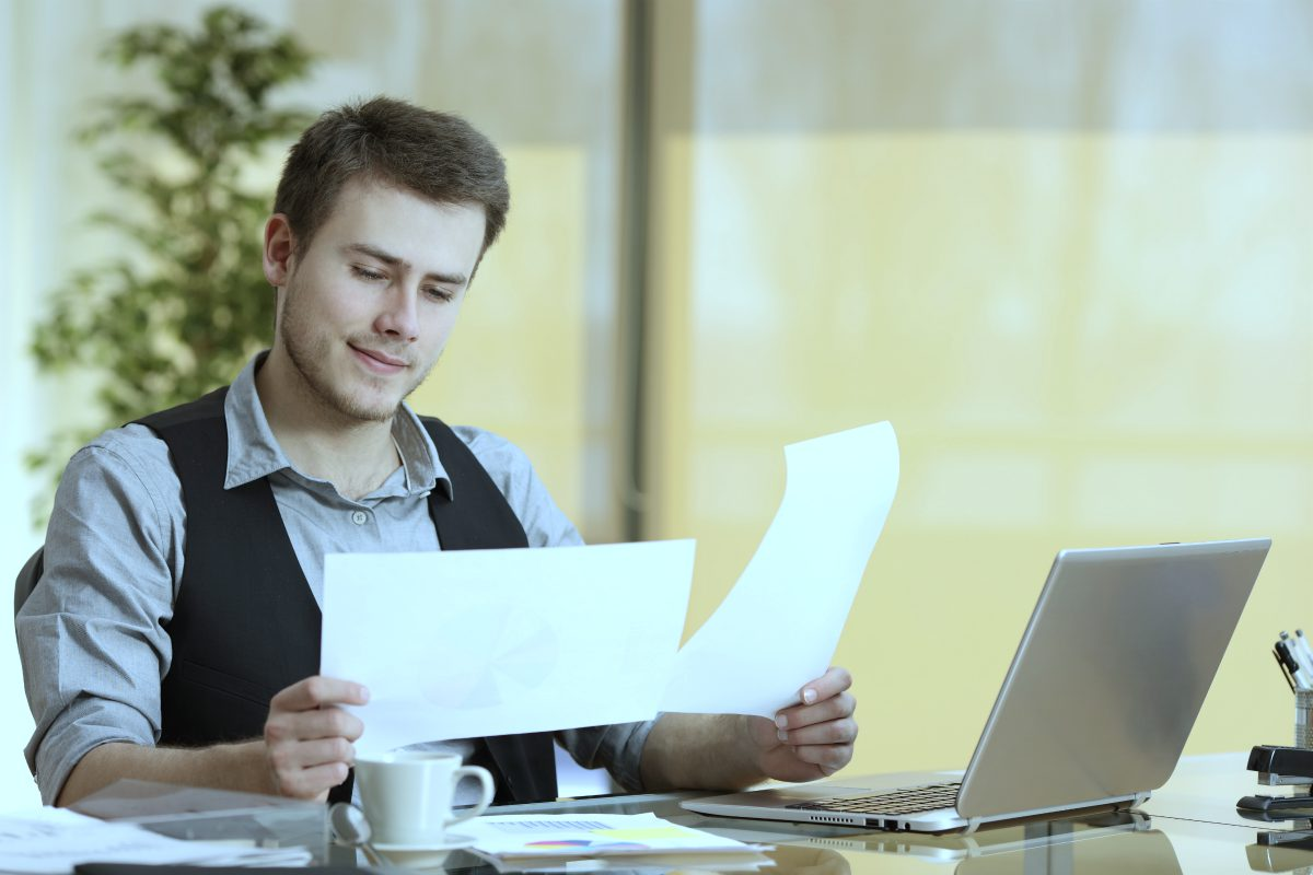 businessman holding documents   Ultimate Estate Planning Checklist and 5 Reasons Why You Need It   purpose of estate planning