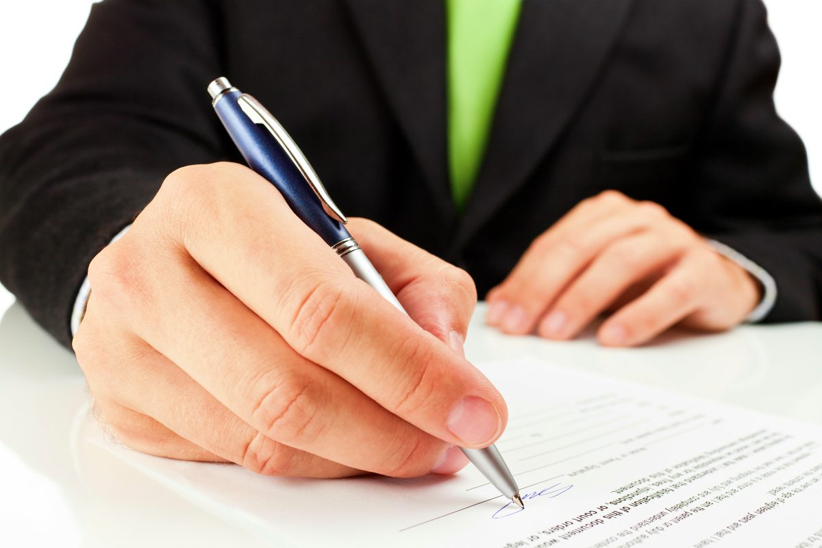 businessman signing document | Ultimate Estate Planning Checklist and 5 Reasons Why You Need It | estate planning basics