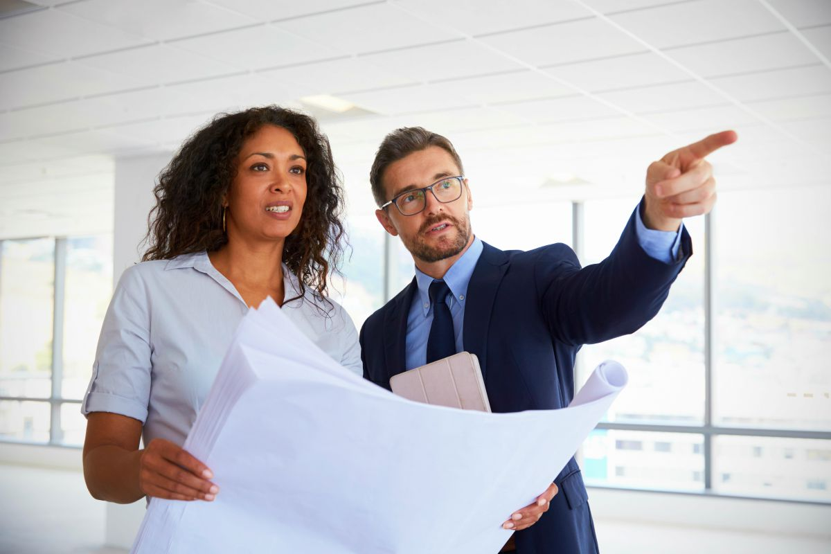 business people talking about real estate | When To Choose IRA Trust Over IRA LLC | Inside Your IRA | ra llc vs ira trust