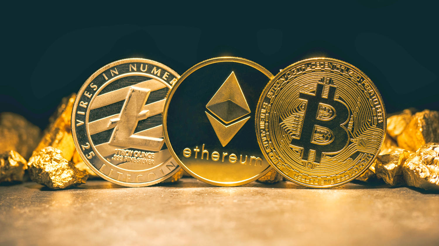 Featured | Golden cryptocurrencys Bitcoin, Ethereum, Litecoin and mound of gold | What Is The Future Of Cryptocurrency?