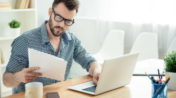 Featured   man reading documents   How To Avoid Taxes On IRA Withdrawals Inside Your IRA   ira withdrawals   avoiding taxes on ira withdrawals