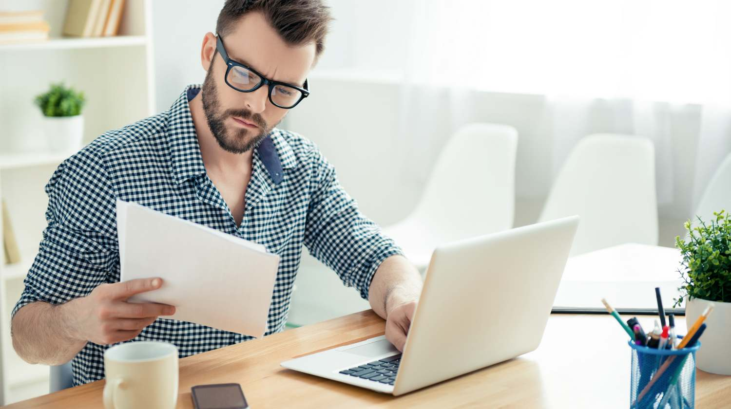 Featured | man reading documents | How To Avoid Taxes On IRA Withdrawals Inside Your IRA | ira withdrawals | avoiding taxes on ira withdrawals