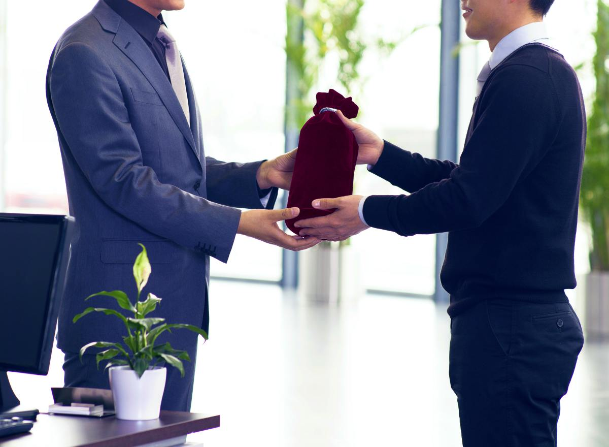 businessman offering gift   Ultimate Estate Planning Checklist and 5 Reasons Why You Need It   estate planning