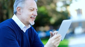 Featured   senior man using tablet   Checkbook IRA: What Is Checkbook Control?   Inside Your IRA   self directed ira checkbook