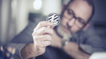 Featured   man holding litecoin   Most Promising Cryptocurrencies Other Than Bitcoin   Inside Your IRA   most promising cryptocurrencies   most promising cryptocurrency